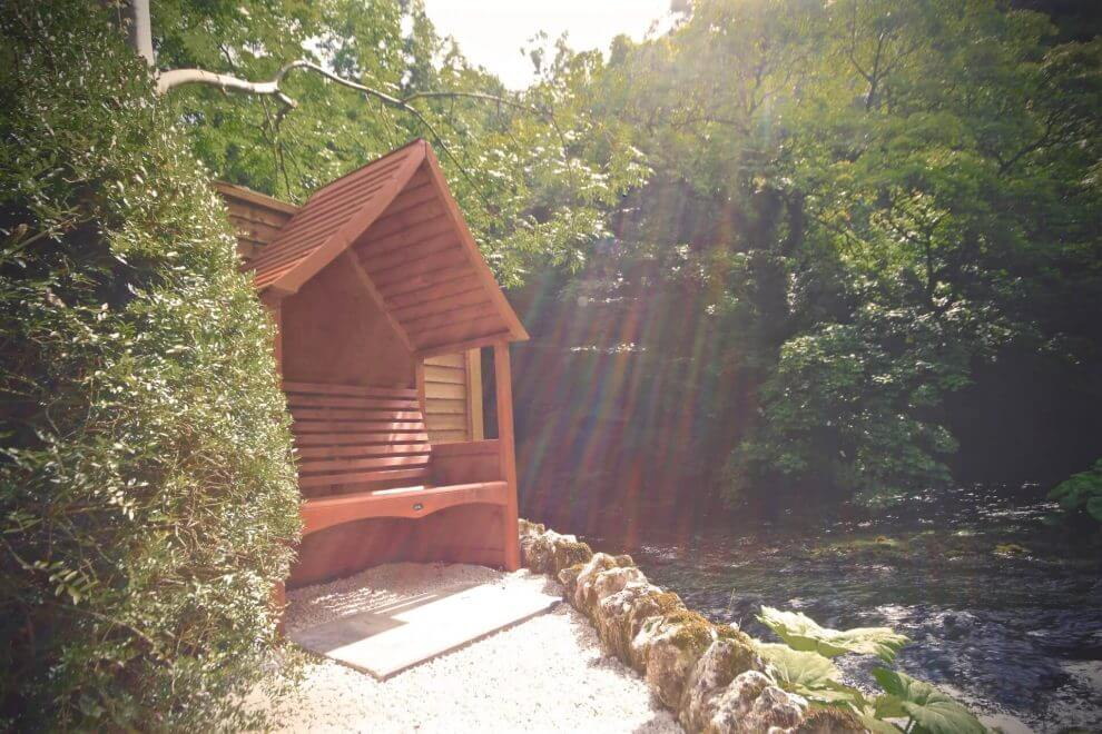 Listen to the river rushing by at the end of our peaceful garden at Angler's Cottage B&B