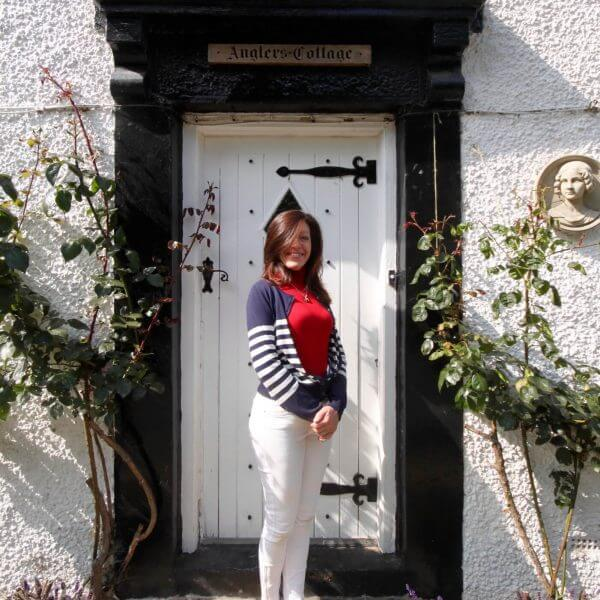 Angler's Cottage B&B original front door, Nicky Carter standing proudly in front of it